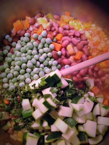 Sweet peas and canned beans make this a hearty vegan soup. Fresh basil adds a pop of fresh flavor