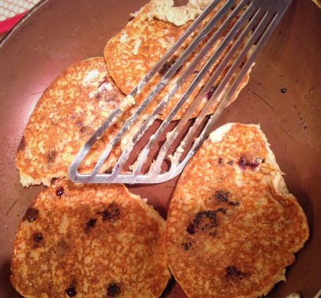 """Chef's Tip: Once the pancakes are golden brown on one side, flip and cook until golden on the second side. For a """"crispier"""" texture, use your spatula to push down the edges"""