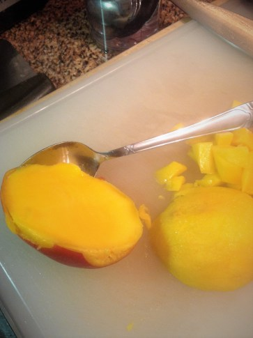 Use a spoon to scoop out the mango flesh. Make sure to save any juices - they add incredible, sweet flavor