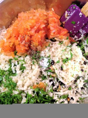 A Greek-inspired stuffing is made with cauliflowr rice, currants, parsley, onion, garlic, oregano, and the tomato pulp.
