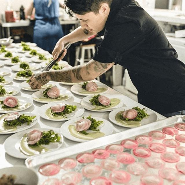 Chef Lexx Ambrose executing a signature dinner collaboration