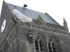 effigy of paratrooper hangs from the steeple