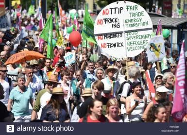 epa04782787-demonstrators-hold-a-sign-reading-no-ttip-no-fracking-ERR54X