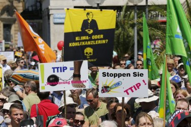 People demonstrate against the Transatlantic Trade and Investment Partnership (TTIP) a proposed free trade agreement between the European Union and the United States, during a protest rally prior to the G7 summit, in Munich, Germany in this June 3, 2015 file picture. Some small businesses fear the Trans Atlantic Trade and Investment Partnership (TTIP) being hammered out between Brussels and Washington will give too much power to big multinationals at the expense of small companies. There is a depth of scepticism towards TTIP in Germany, Europe's largest economy, where media coverage has focused largely on protests from anti-globalisation groups and labour unions. It also highlights the challenge facing German Chancellor Angela Merkel as she tries to overturn entrenched suspicion of the pact. REUTERS/Wolfgang Rattay/Files