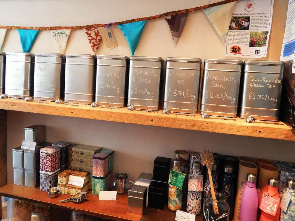 Canisters of loose leaf tea on a shelf