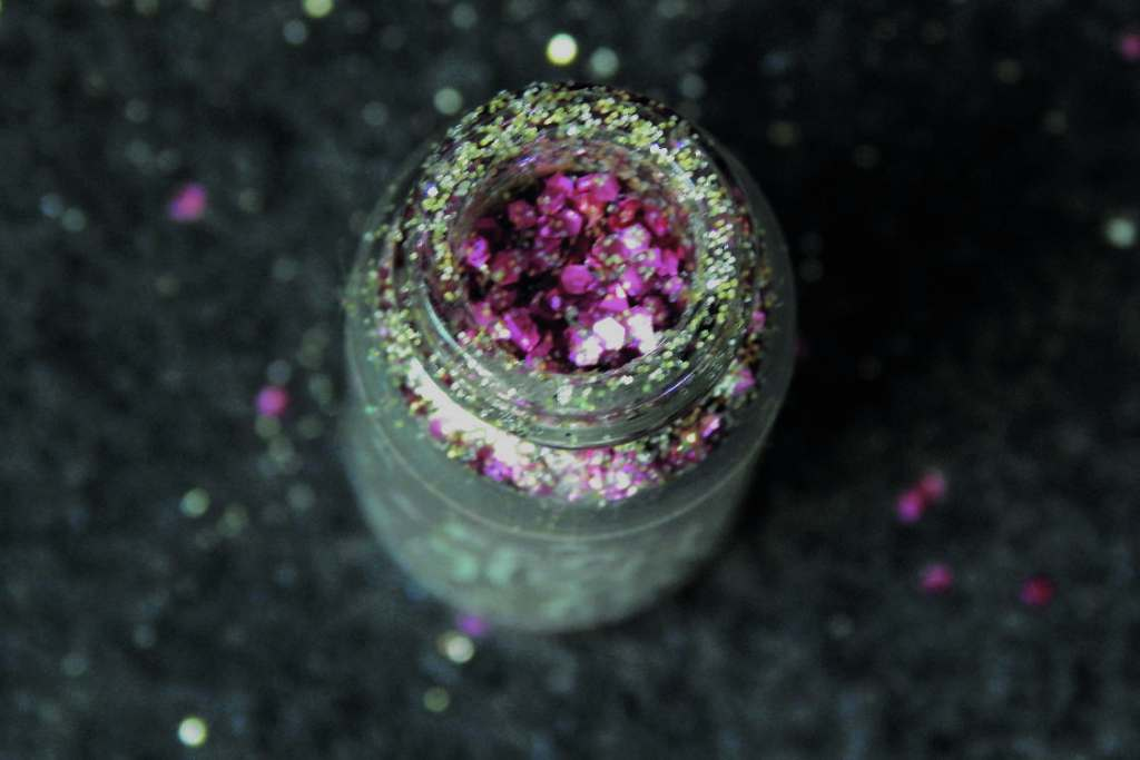 Pink and gold glitter in a glass pot