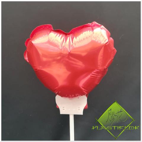 Ballon coeur rose sur stick ©Plastiflor