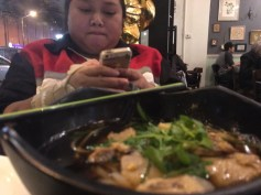 Melo taking pictures of her soup