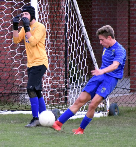 Dillon Schmitt kicks the ball. Editor's Note: Does anyone know what Ethan Tate is doing with his hands?