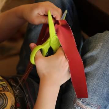 Child cutting colored paper