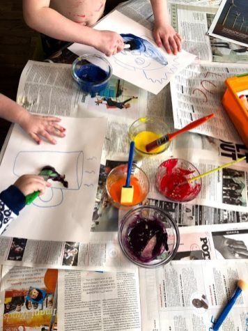 Children painting with egg yolks