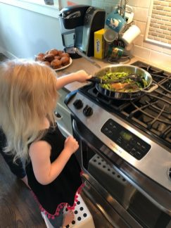Child cooking asparagus
