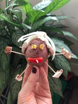 Child holding Ms. Potato craft