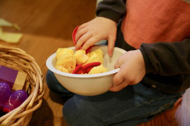 Child stirring tissue paper tortellini