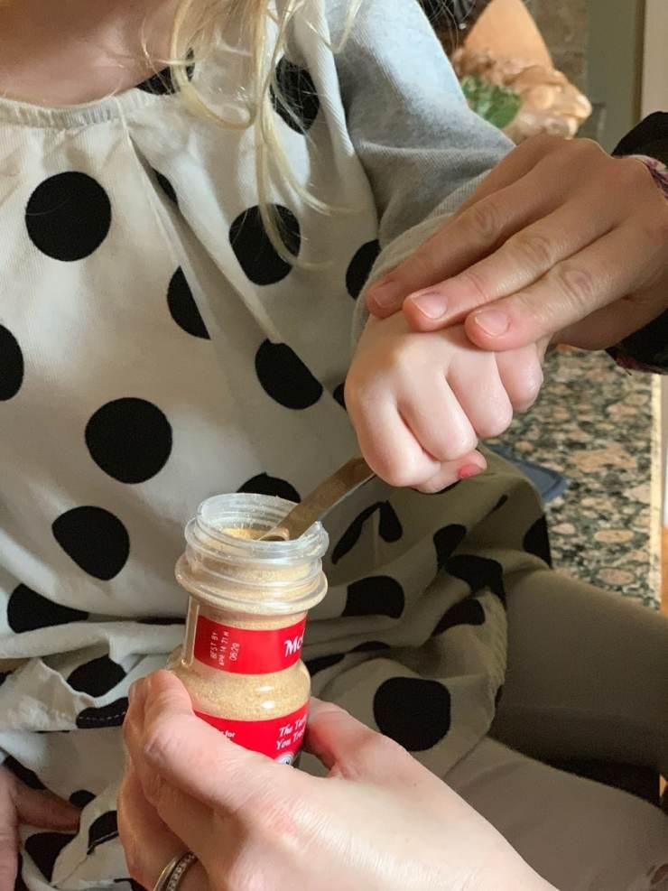 Child measuring seasoning