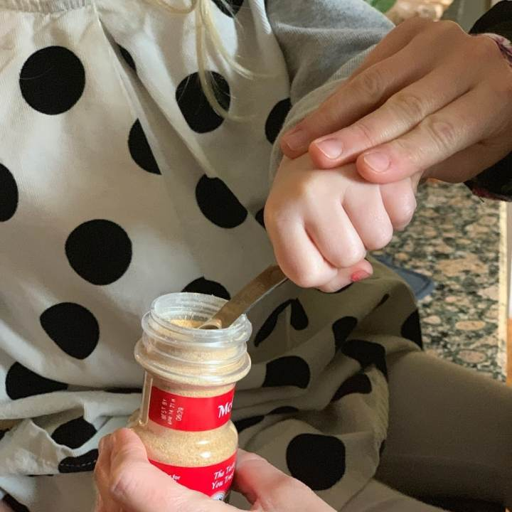 Child measuring seasoning
