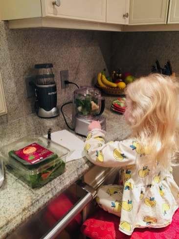 Child mixing veggies