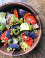 Three Potato Salad with Roasted Red Peppers & Olives, in a bowl