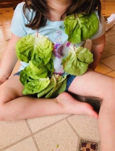 Child wearing lettuce leaf necklace