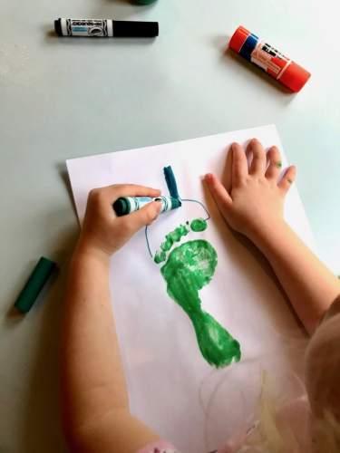 child adding stem to pepper