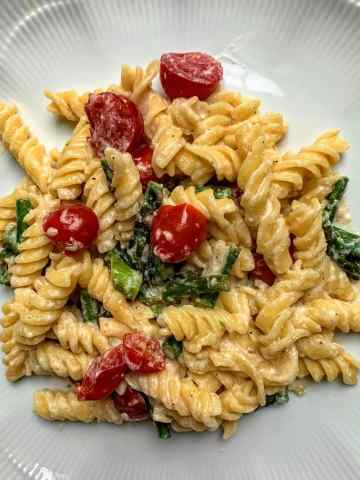 Three Cheese Pasta with Lemon, Cherry Tomatoes & Asparagus on plate
