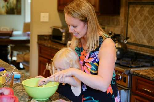 mother cooks with daughter