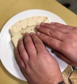 Fold up bottom part of tortilla