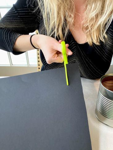 cutting thin strip black paper