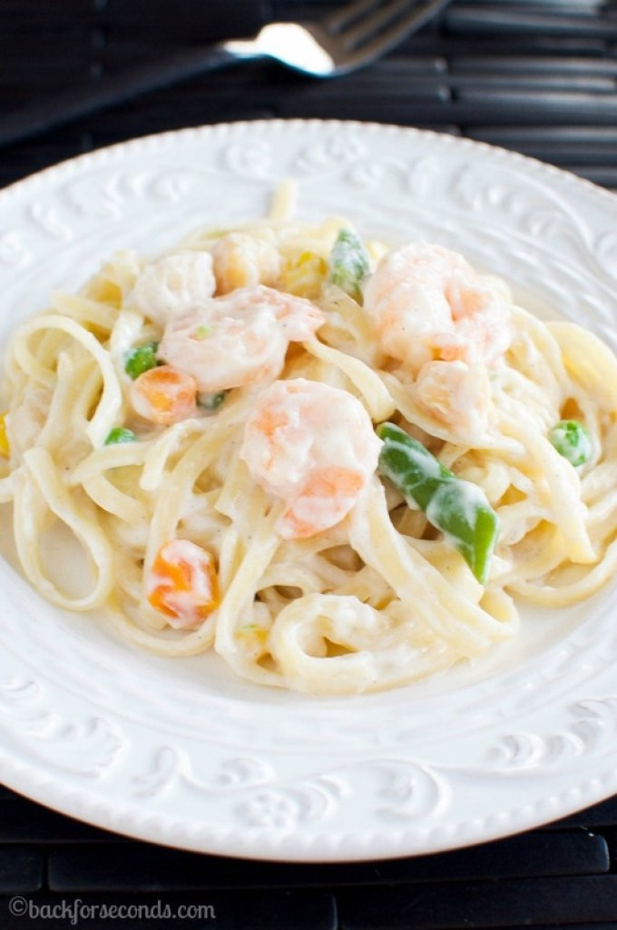 Seafood Primavera made with chemical free shrimp and scallops, fresh spring vegetables, tossed with pasta in a rich, flavorful cream sauce.