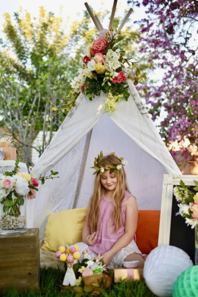 Boho chic party with lots of amazing details. Love the teepee with flowers!