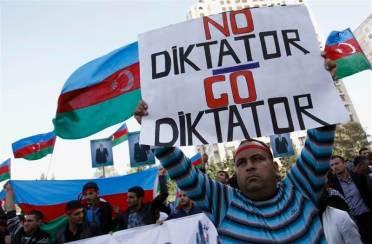 A man attends an opposition rally in Baku