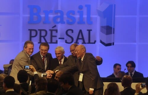 Brazil's Mines and Energy Minister Edison Lobao meets representatives of the consortium winner of the auction for the  Libra offshore oilfield during a ceremony in Rio de Janeiro