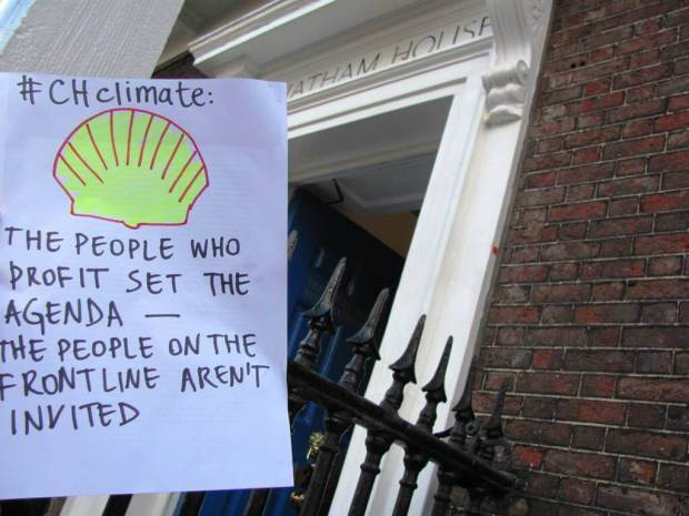 """Placard: """"The people who profit set the agenda - the people on the frontline aren't invited"""""""