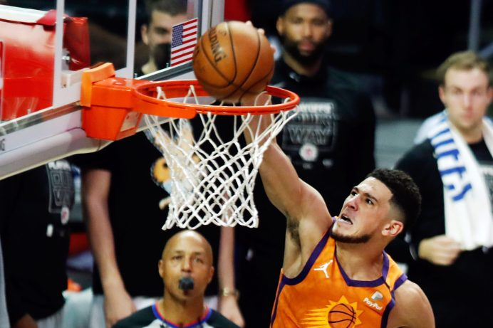 epa09314584 Phoenix Suns guard Devin Booker scores during the second quarter of game 6 of the NBA playoffs Western Conference final between the Phoenix Suns and the Los Angeles Clippers at the Staples Center in Los Angeles, California, USA, 30 June 2021. EPA/ETIENNE LAURENT SHUTTERSTOCK OUT
