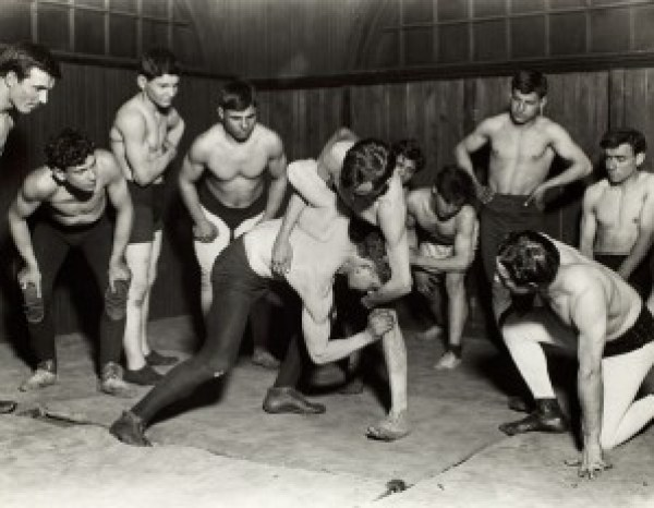 Lewis W. Hine (American, 1874 – 1940) photo of Greek Wrestling Club, 1910, from the series Hull House, Chicago.