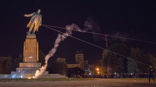 "Ukrainian protestors pull down statue of Lenin. Kharkiv, September 28th, 2014. Note ""Glory to Ukraine!"" and Right Sector logo spray-painted on base."