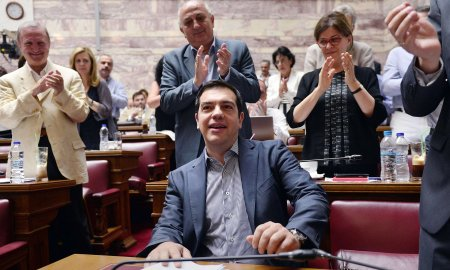 Greek prime minister Alexis Tsipras is applauded by lawmakers before addressing his parliamentary group meeting in Athens on July 10, 2015. Photograph: Louisa Gouliamaki/AFP/Getty Images
