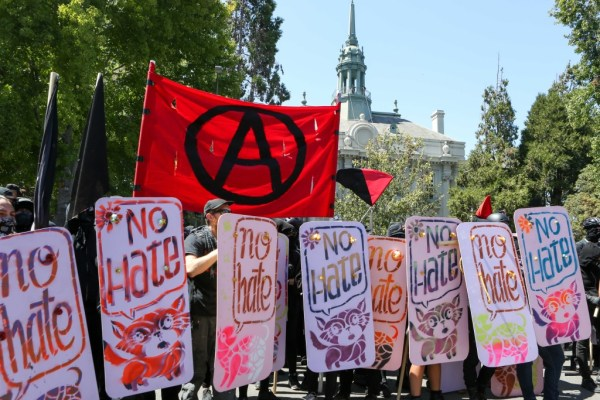 "Anarchists and anti-fascists hold ""no hate"" shields at the counter-protest for ""No To Marxism"" rally in Berkeley, California, on August 27, 2017."