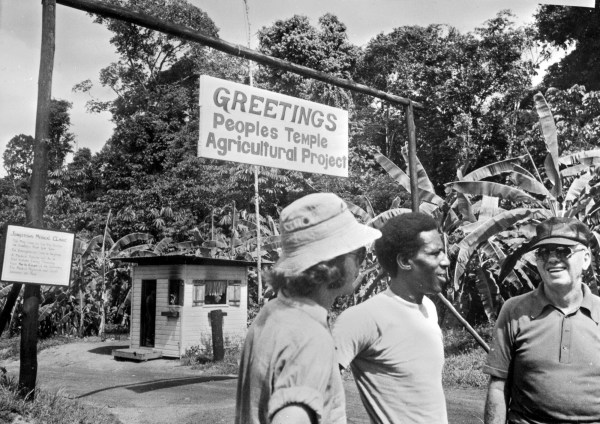 """A 1978 photo of the People's Temple Agricultural Project in northwestern Guyana, also known as """"Jonestown"""", led by cult leader Jim Jones. On November 18, 1978, 909 cult members died by """"revolutionary suicide"""" from cyanide poisoning, orchestrated by Jim Jones, and five other people were murdered by Temple members."""