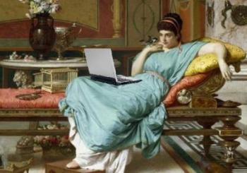 Victorian reclining with a laptop