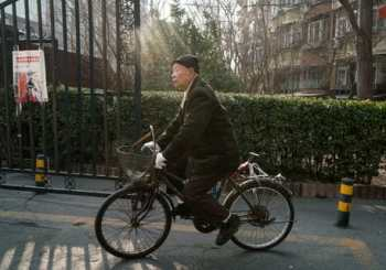 Chinese man on bike