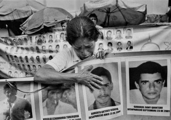 Colombian Woman with Pictures of the Missing