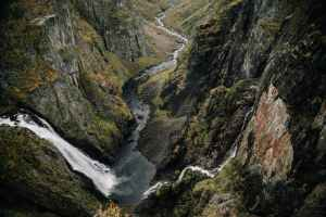 waterfall in mountainous terrain with steep slopes
