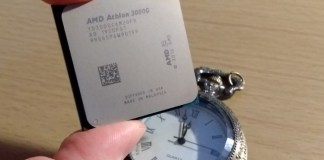 An amd athlon 3000g overclock - literally held above a clock.