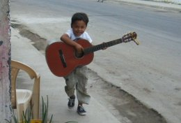 A Serenade For Lisa (Jama, Ecuador) 'Pederico called from across the street, ran inside and retrieved his guitar, then played and sang me a song!