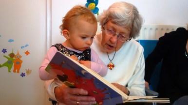 Grandma reading to grandkid
