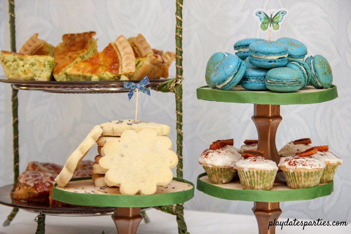 Mother's Day Brunch foods including blue rose champagne macarons, mini French toast cupcakes, lavender shortbread, and quiche wedges