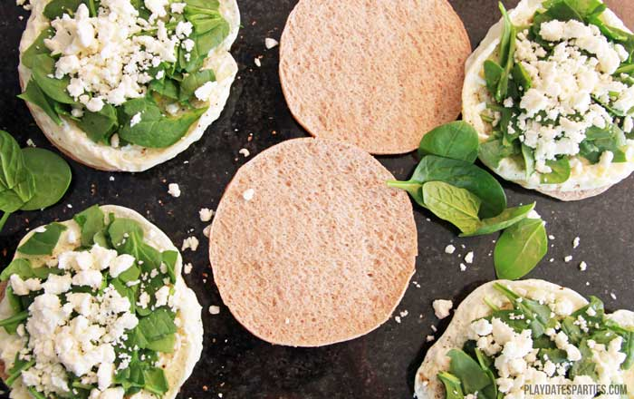 Start your day off right with filling and healthy egg white, spinach, and feta breakfast sandwiches. Best of all...they can be made ahead for busy mornings!