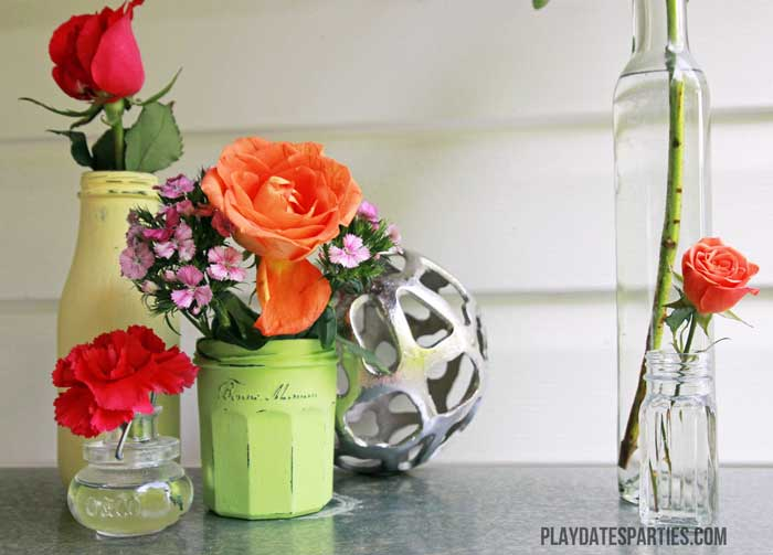 Old glass jars make perfect vases when painted with chalk paint and distressed.