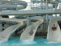 Red Oaks Waterpark has a Soak Station, children's water playground. Spray & Play, a water play area for toddlers. River Ride. Waterpark features include a giant wave-action pool and triple water slide, playground, sun bathing deck, sun shelter and a modern bathhouse with lockers, showers and restrooms.